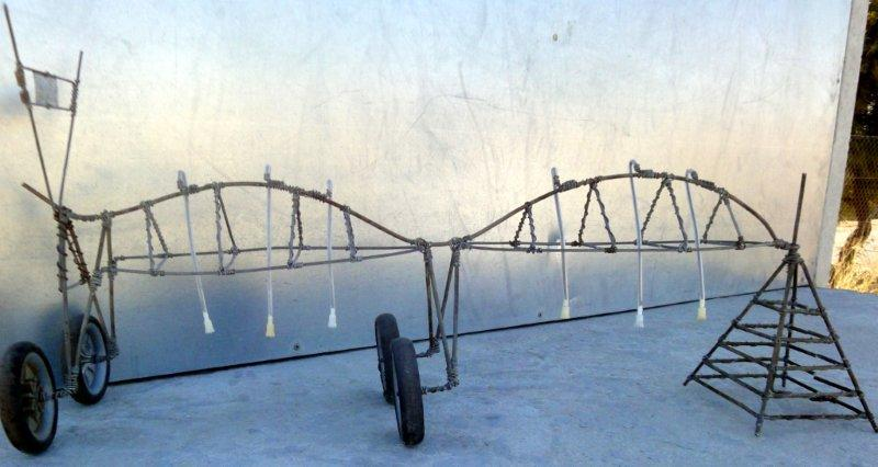 A new product – the very first irrigation pivot in miniature.    Ashton Sauls made this one on order as a gift for one of the irrigation farmers in the district.